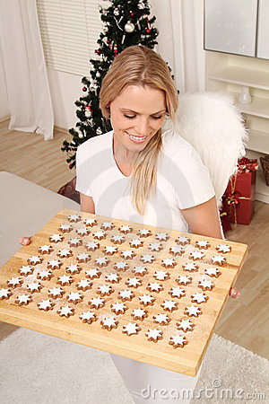 Blond angel with cookies