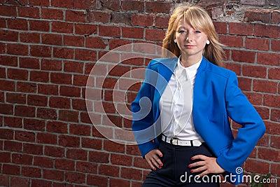 Blond on background from bricks