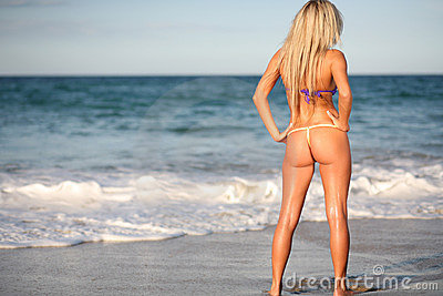 Blond bikini model on beach