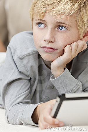 Blond Blue Eyes Boy Child Using Tablet Computer