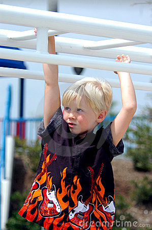 Blond Boy Child On Bars