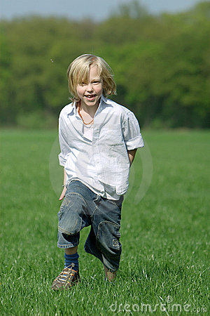 Blond boy laughing and running
