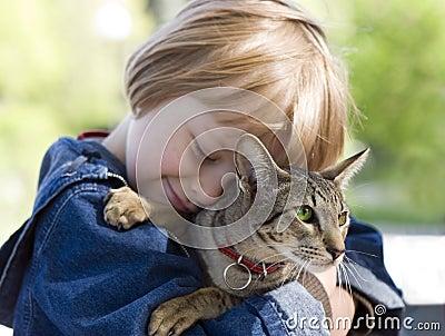Blond boy with oriental bred cat