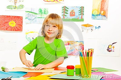Blond boy on preschool art class