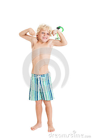 Blond boy wearing swimming shorts with swimming mask. The boy shows muscles.