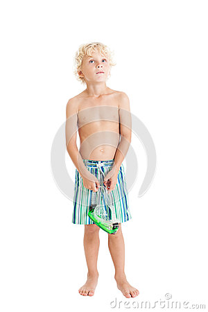 Blond boy wearing swimming shorts with swimming mask. Looking up.