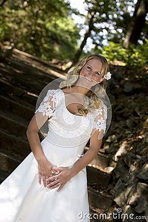 Blond bride in white dress