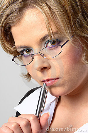 Blond business woman with glasses closeup
