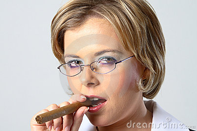 Blond business woman smoking a cigar