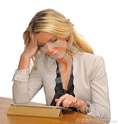 Blond business woman with tablet