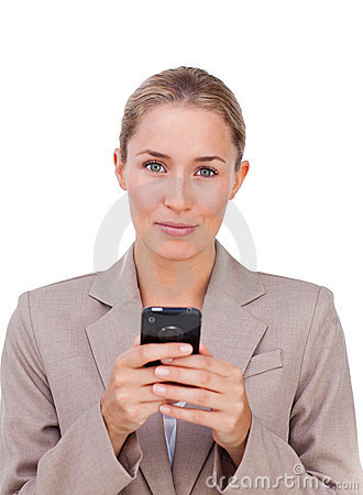 Blond businesswoman sending a text
