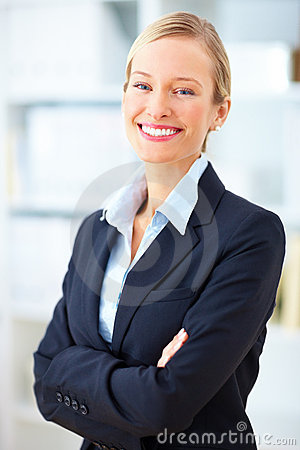 Blond businesswoman standing with crossed arms