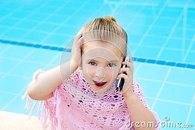 Blond child little girl talking mobile phone