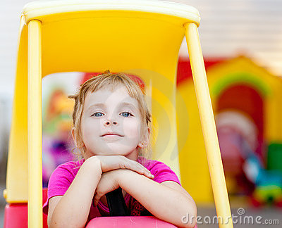 Blond Children Girl Relaxed Driving Toy Car Royalty Free Stock Image - Image: 21473986