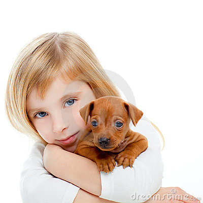 Free Blond Children Girl With Dog Puppy Mini Pinscher Royalty Free Stock Photography - 22067597