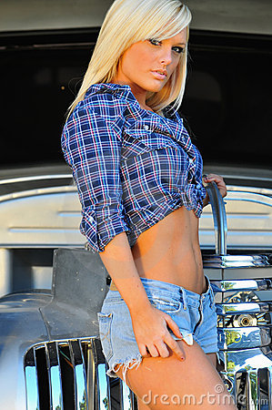 Blond country girl in front of classic auto