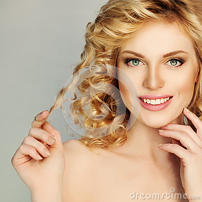 Free Blond Curly Hair Girl. Beautiful Smiling Woman Touch Her Hair Stock Photos - 60196573