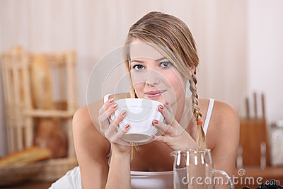 Blond drinking from bowl