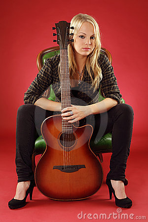 Blond female with acoustic guitar