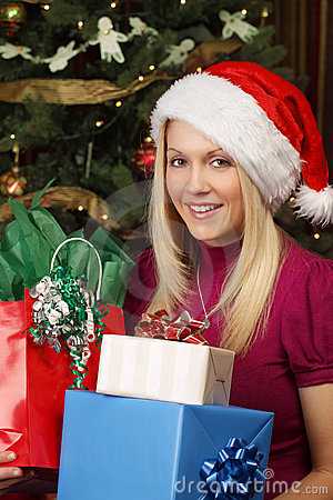 Blond female holding Christmas presents