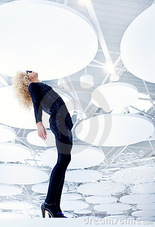 Blond futuristic vintage sexy woman in black