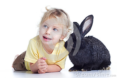 Blond girl and black rabbit