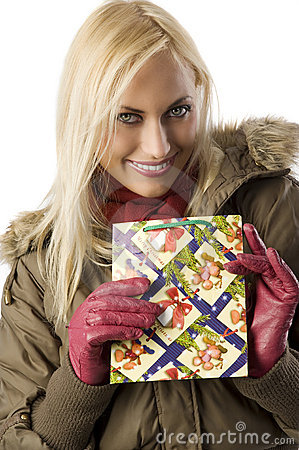 Blond girl with christmas bag