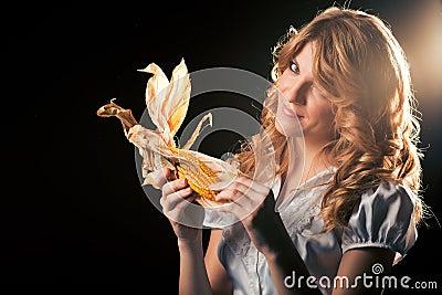 Blond girl with corncob