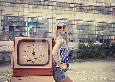 Blond girl on damaged gas station