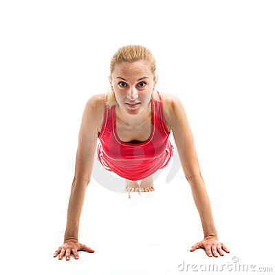 Blond girl doing gymnastic exercises