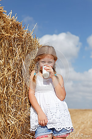 Blond girl drinking milk