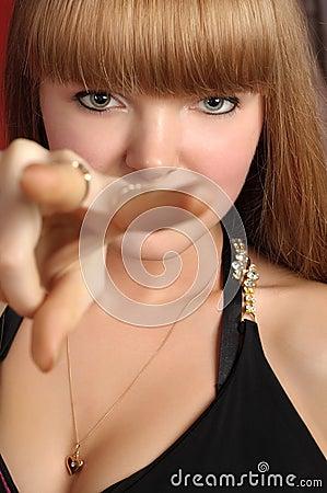 Blond girl forks her fingers