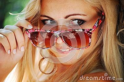 Blond girl in glasses