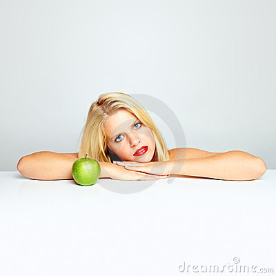Blond girl and green apple
