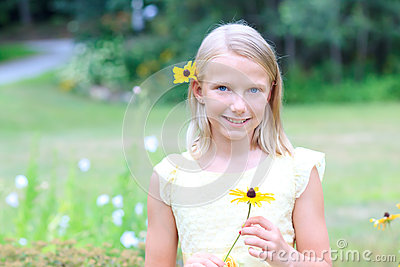Blond Girl Holding a Flower