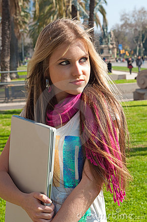 Blond girl holding a laptop