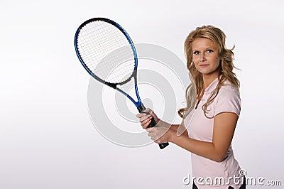 Blond girl holding a tennis racket