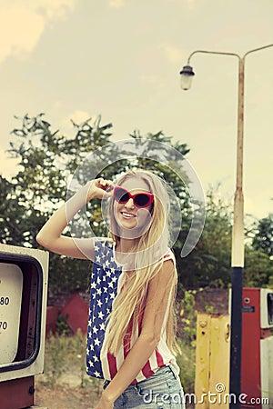 Blond girl holds hands on her glasses