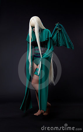 Free Blond Girl In Green Fury Cosplay Character Stock Photos - 23027683