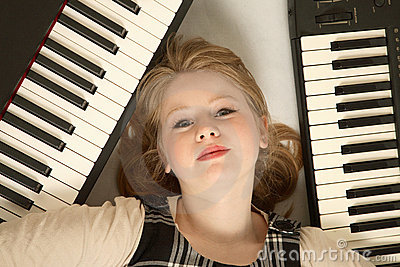Blond girl and keyboards