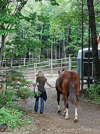 BLOND GIRL LEADING HORSE (click image to zoom)