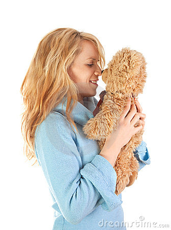 Blond girl loves teddy bear