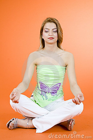 Blond girl meditating