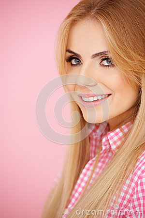 Blond girl on pink with copyspace