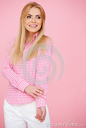 Blond girl in pink, standing full-length