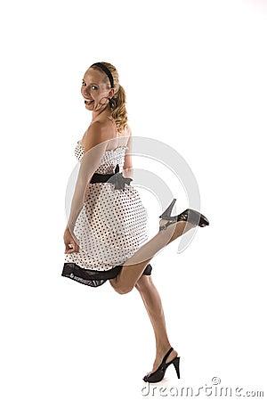 Blond girl in polka dot dress