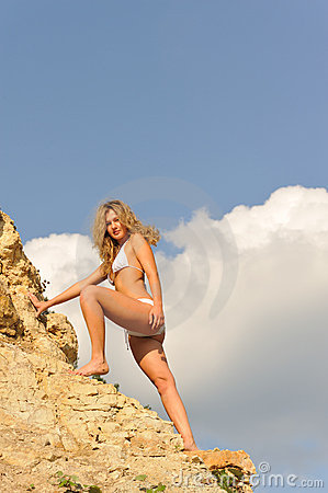 Blond girl on rock