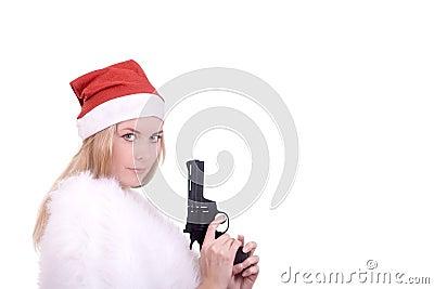 Blond girl in Santa hat with gun