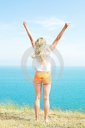Blond girl in shorts