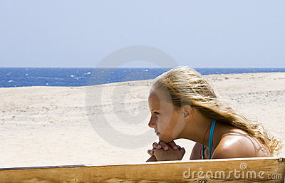 Blond girl sitting on the bench